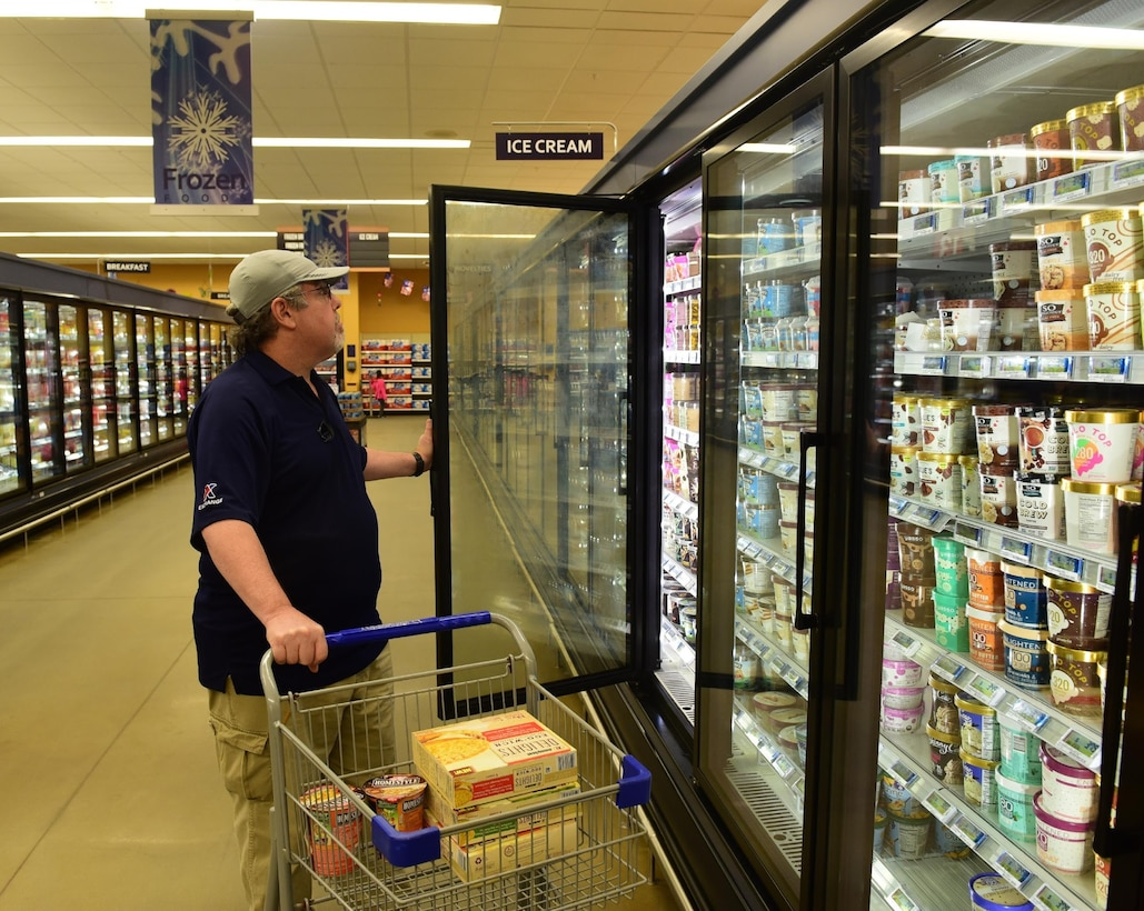 A customer checks out the newly stocked chilled items Nov. 19, 2018, at the Tyndall Air Force Base Commissary. Several customer-service organizations reopened Nov. 17 for DOD ID cardholders to utilize. Many services on Tyndall were temporarily shut down due to the damage from Hurricane Michael. (U.S. Air Force photo by Senior Airman Cody R. Miller)