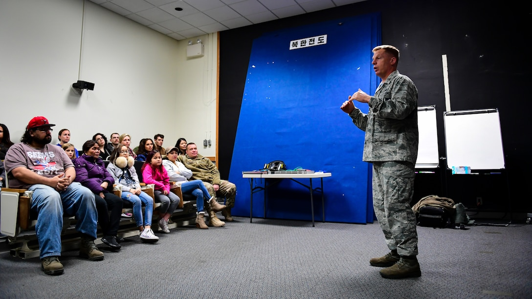 U.S. Air Force Col. Les Olberg, commander of the 694th Intelligence, Surveillance and Reconnaissance Group, welcomes spouses and families of Air and Space Operations Center Airmen to a tour of their facility on Osan Air Base, Nov. 16, 2018.