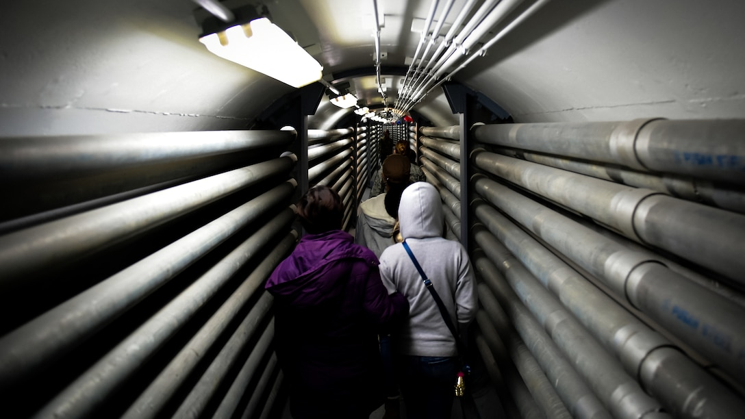 Families of 694th Air and Space Operations Center walk through an underground hallway during a tour of the ISRG and Korean Combined Operations and Intelligence Center on Osan Air Base, Nov. 16, 2018.
