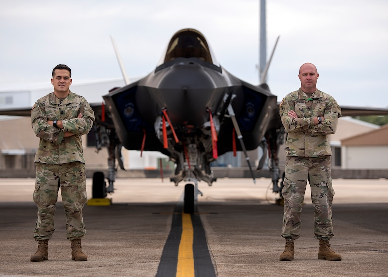 From left, U.S. Army Capt. John Logan and Sgt. 1st Class Patrick Brodhead, 33rd Operations Support Squadron ground liaison officers, stand in front of an F-35A Lightning II assigned to the 33rd Fighter Wing Nov. 6, 2018, at Eglin Air Force Base, Fla. Logan and Brodhead are the only Soldiers assigned to the 33rd FW, however their role is significant for the employment of the F-35A. As ground liaison officers their mission is to track, understand and brief the enemy ground formation from the battlefield to pilots and intelligence Airmen. (U.S. Air Force photo by Staff Sgt. Peter)
