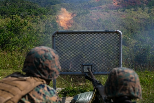 Sgt. Vanessa Crump and Lance Cpl. Zackery Meetze, motor transportation operators with Truck Company, Headquarters Battalion, 3rd Marine Division, fire the course of fire during their proficiency training, Nov. 8, 2018 on Range 7, Camp Hansen, Okinawa, Japan. Truck Company is currently conducting pre-deployment training for the Integrated Training Exercise (ITX) in January 2019. (U.S. Marine Corps photo by Lance Cpl. Timothy Hernandez)