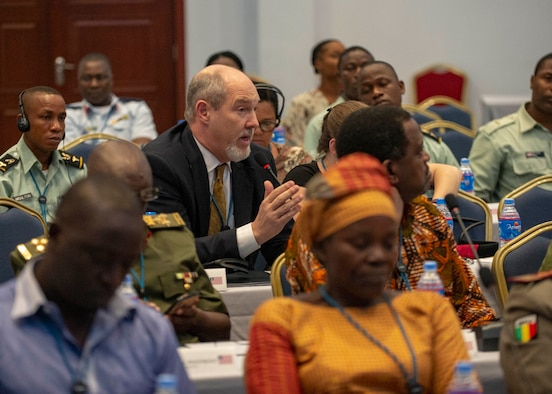 Chris Daniel, senior advisor for Global Health Engagement, asks a question during an African Partner Outbreak Response Alliance (APORA) conference in Monrovia, Liberia. During APORA, military and civilian leaders will work together to align best practices and improve response capabilities for potential outbreaks of contagious diseases. The training will help bolster relationships with current partners, and mobilize new partners to strengthen pandemic programs. (U.S. Navy photo by Mass Communication Specialist 2nd Class Robert J. Baldock)