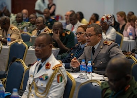 Lieutenant Colonel Arbi Bouaiti, Royal Moroccan Armed Forces, asks a question during an African Partner Outbreak Response Alliance (APORA) conference in Monrovia, Liberia. During APORA, military and civilian leaders will work together to align best practices and improve response capabilities for potential outbreaks of contagious diseases. The training will help bolster relationships with current partners, and mobilize new partners to strengthen pandemic programs. (U.S. Navy photo by Mass Communication Specialist 2nd Class Robert J. Baldock)