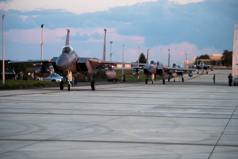 Four F-15C Eagles assigned to the 493rd Fighter Squadron taxi at Amendola Air Base, Italy, Nov. 16, 2018. F-15C Eagles and an F-15D Eagle will be participating in the NATO Tactical Leadership Programme 18-4. TLP has prepared hundreds of NATO and allied forces' flight leaders to be mission commanders. (U.S. Air Force photo/ Senior Airman Malcolm Mayfield)