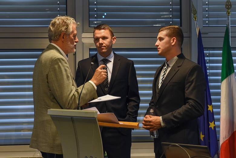 U.S. Air Force Staff Sgt. Michael Stoermer, 31st Contracting Squadron contract manager, right, and U.S. Air Force 2nd Lt. Oleksandr Bakuta, 31 CONS contract manager, center, speak with an Italian contractor during the Industry Day conference in Pordenone, Italy, Nov. 9, 2018. The conference was an opportunity for the 31 CONS to develop a better working relationship with local businesses, as well as offer more information to these businesses about working on the installation.
