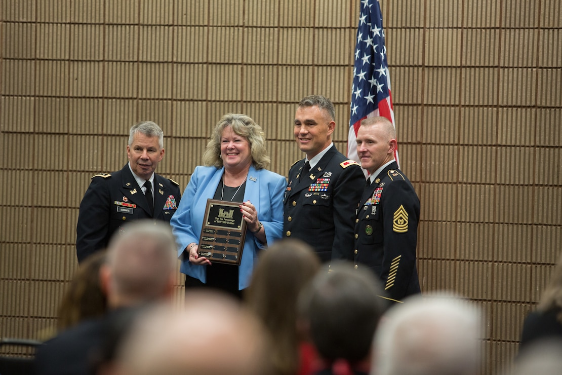 Lt. Gen. Todd T. Semonite (left)  and Sgt. Maj. Bradley J Houston (right) presents Cherie Kunze and Col. Patrick Kinsman with an award for being the seventh best district throughout the U.S. Army Corps of Engineers for awarding contracts to Service Disabled Veteran Owned Small Businesses.