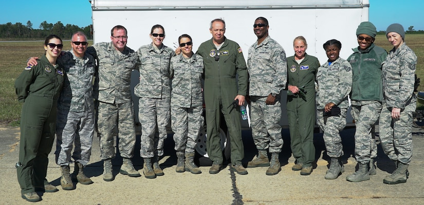 Reserve Citizen Airmen from the 315th Aeromedical Evacuation Squadron and 317th Airlift Squadron pose for a group photo during an operational readiness exercise at North Auxiliary Airfield, S.C., Nov. 17, 2018. The exercise provided the 315th Operations Group with hands-on training in a variety of airlift and aeromedical evacuation tactics during simulated combat events. (U.S. Air Force photo by Staff Sgt. Andrew Fox)
