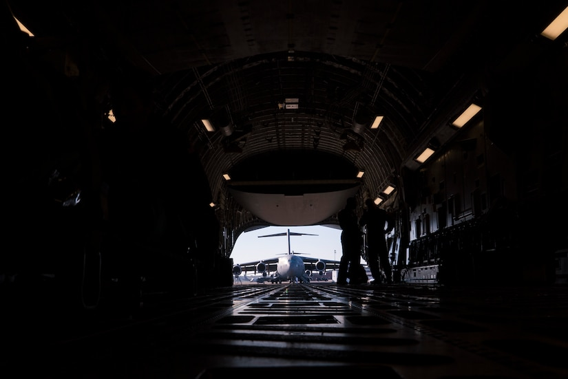 Reserve Citizen Airmen from the 315th Aeromedical Evacuation Squadron load medical equipment onto a C-17 Globemaster III during an operational readiness exercise at Joint Base Charleston, S.C., Nov. 17, 2018. The exercise provided the 315th Operations Group with hands-on training in a variety of airlift and aeromedical evacuation tactics during simulated combat events. (U.S. Air Force photo by Staff Sgt. Nicholas A. Priest)