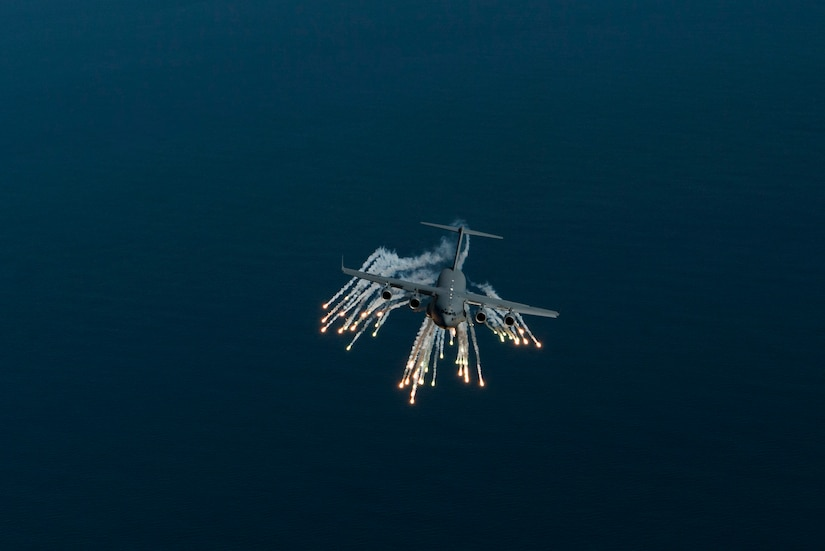 A C-17 Globemaster III aircraft assigned to 315th Airlift Wing out of Joint Base Charleston, S.C., deploys flares as part of an operational readiness exercise Nov. 17, 2018. The exercise provided the 315th Operations Group with hands-on training in a variety of airlift and aeromedical evacuation tactics during simulated combat events. (U.S. Air Force photo by Staff Sgt. Nicholas A. Priest)