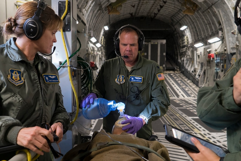 Air Force Reserve Lt. Col. David Ferguson and Tech. Sgt. Brigid Dye perform medical care to a simulated patient on a C-17 Globemaster III during an operational readiness exercise near Charleston, S.C., Nov. 17, 2018. The exercise provided the 315th Operations Group with hands-on training in a variety of airlift and aeromedical evacuation tactics during simulated combat events. Ferguson and Dye are both assigned to the 315th Aeromedical Evacuation Squadron. (U.S. Air Force photo by Staff Sgt. Nicholas A. Priest)