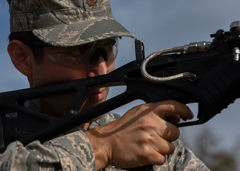 U.S. Air Force Maj. Benjamin Moran, U.S. Embassy Security Cooperation Office operations officer takes aim during a non-lethal weapons demonstration at Joint Base Langley-Eustis, Virginia, Nov. 8, 2018.