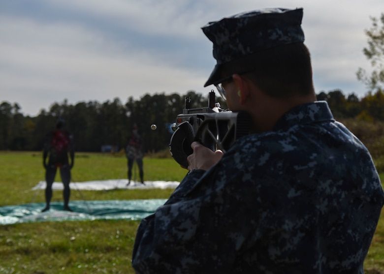 A student in the Joint Non-Lethal Weapons Program class fires at a target during a demonstration at Joint Base Langley-Eustis, Virginia, Nov. 8, 2018.