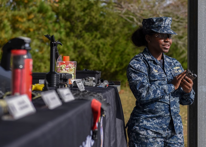 U.S. Navy 1st Lt. Shannon Davis, Joint Non-Lethal Weapons Program surface warfare officer, talks about weapons options during a demonstration at Joint Base Langley-Eustis, Virginia, Nov. 8, 2018.