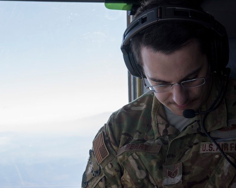 A loadmaster assigned to the 6th Airlift Squadron, Joint Base McGuire-Dix-Lakehurst, N.J., glances down at a map during Exercise JERSEY WRATH 19-1 over Arizona Nov. 13, 2018. Bases from across the country including Luke Air Force Base participated in the mobility-centric training exercise. (U.S. Air Force photo by Airman 1st Class Jacob Wongwai)