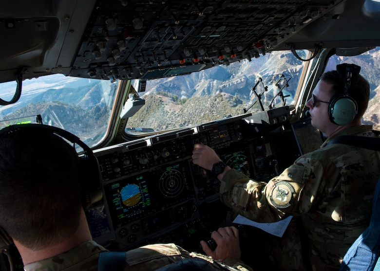 Pilots assigned to the 6th Airlift Squadron, Joint Base McGuire-Dix-Lakehurst, N.J., fly a C-17 Globemaster III cargo aircraft during Exercise JERSEY WRATH 19-1 over Arizona Nov. 13, 2018. The mobility-centric training exercise highlighted integration between mobility and combat assets in a realistic training scenario. (U.S. Air Force photo by Airman 1st Class Jacob Wongwai)