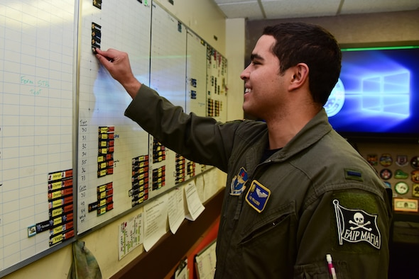 """1st Lt. Alexander Frazier, 85th Flying Training Squadron T-6A instructor pilot and flight scheduler, plans his student's flight schedule Nov. 19, 2018, at Laughlin Air Force Base, Texas. Frazier was chosen by wing leadership to be the """"XLer"""" of the week, for the week of Nov. 5, 2018, at Laughlin Air Force Base, Texas. (U.S. Air Force photo by Airman 1st Class Marco A. Gomez)"""