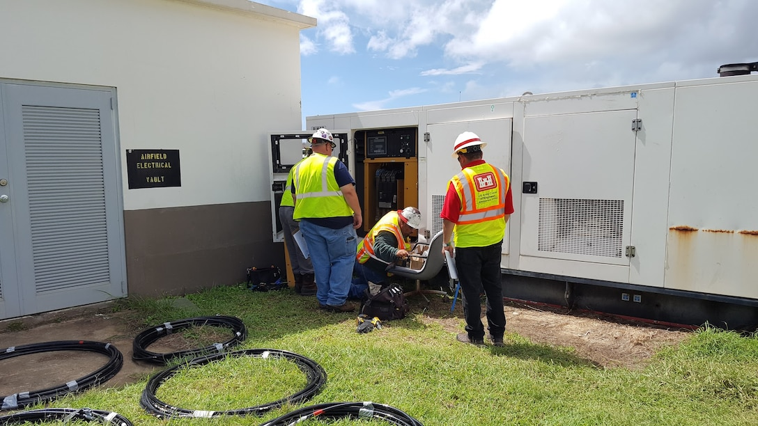 SAN JUAN, Puerto Rico, -- A contractor installs a generator for FEMA post-Hurricane Maria while a District employee looks on, Sept. 29, 2017. The District has a power team that responds to disasters by installing generators for needed emergency power. This generator was the second installed through the power team and was at Roosevelt Roads in support of a FEMA field office. Photo by Shannon Silva. This was a 2018 photo drive entry.