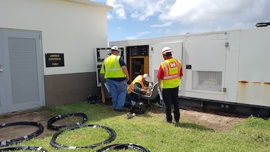 SAN JUAN, Puerto Rico, -- A contractor installs a generator for FEMA post-Hurricane Maria while a District employee looks on, Sept. 29, 2017. The District has a power team that responds to disasters by installing generators for needed emergency power. This generator was the second installed through the power team. Photo by Shannon Silva. This was a 2018 photo drive entry.