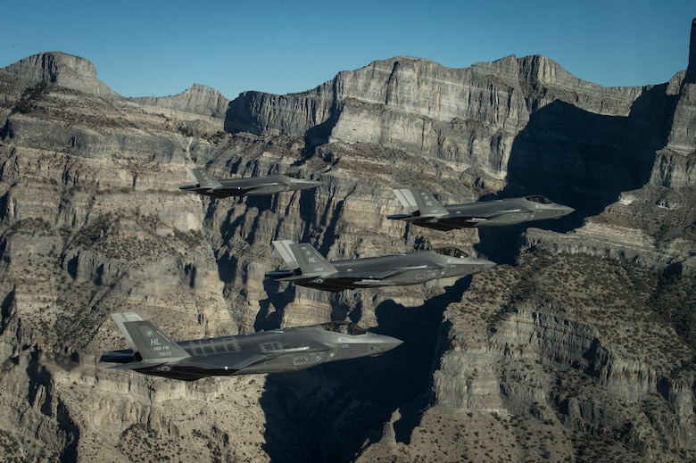 A formation of F-35 Lightning IIs from the 388th and 419th Fighter Wings stationed at Hill Air Force Base perform aerial maneuvers during as part of a combat power exercise over Utah Test and Training Range, Nov. 19, 2018. The exercise aims to confirm their ability to quickly employ a large force of jets against air and ground targets, and demonstrate the readiness and lethality of the F-35A. As the first combat-ready F-35 unit in the Air Force, the 388th and 419th FW are ready to deploy anywhere in the world at a moment's notice.  (U.S. Air Force photo by Staff Sgt. Cory D. Payne)