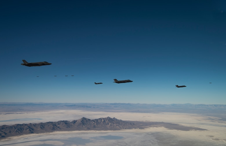 A formation of 35 F-35A Lightning IIs, from the 388th and 419th Fighter Wings fly over the Utah Test and Training Range as part of a combat power exercise on Nov. 19, 2018. The exercise aims to confirm their ability to quickly employ a large force of jets against air and ground targets, and demonstrate the readiness and lethality of the F-35. As the first combat-ready F-35 units in the Air Force, the 388th and 419th FW at Hill Air Force Base, Utah, are ready to deploy anywhere in the world at a moment's notice. (U.S. Air Force photo by Staff Sgt. Andrew Lee)