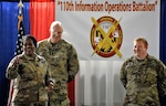U.S. Army Sgt. 1st Class Quintin C. Steele, intelligence specialist, stands with Sgt. Maj. Perlisa D. Wilson, senior enlisted leader, and Lt. Col. Stephen P. Gerber, a senior intelligence officer, during a promotion ceremony at the 110th Information Operations Battalion Nov 18, 0218, in Annapolis, Md. Steele's promotion speech sparked an emotional expression of gratitude to his unit for the support he received as his family lived through the devastation of Hurricane Michael in Panama City, Fla.