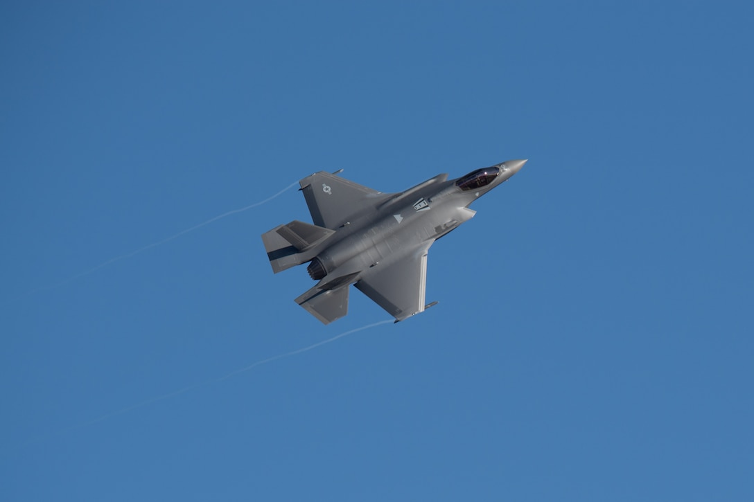 A F-35A Lightning II from the 388th and 419th Fighter Wing fly by as part of a combat power exercise at Hill Air Force Base, Utah. The exercise aims to confirm their ability to quickly employ a large force of jets against air and ground targets, and demonstrate the readiness and lethality of the F-35 Lightning II. As the first combat-ready F-35 units in the Air Force, the 388th and 419th FWs are ready to deploy anywhere in the world at a moment's notice. (United States Air Force photo/Cynthia Griggs)