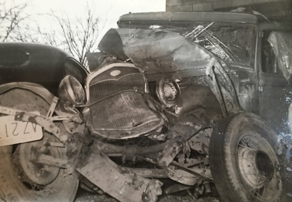 B&W phot, wrecked 1930s car