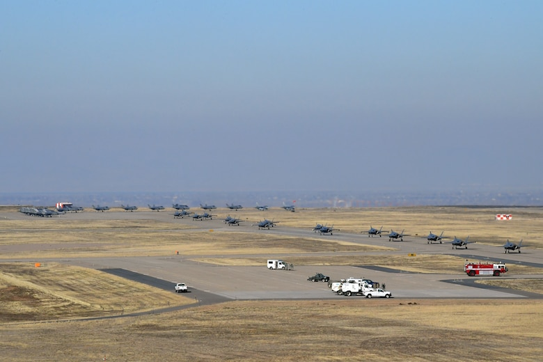 F-35A pilots from the 388th and 419th Fighter Wing taxi as they prepare for takeoff prior to a combat power exercise at Hill Air Force Base, Utah. The exercise aims to confirm their ability to quickly employ a large force of jets against air and ground targets, and demonstrate the readiness and lethality of the F-35 Lightning II. As the first combat-ready F-35 units in the Air Force, the 388th and 419th FWs are ready to deploy anywhere in the world at a moment's notice. (United States Air Force photo/Todd Cromar)