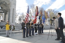"""On Nov. 20, 2018 a trumpet player from """"The President's Own"""" U.S. Marine Band performed for the ceremony and wreath presentation at the World War II Memorial's Pacific Arch to mark the 75th anniversary of the Battle of Tarawa. The 1943 U.S. amphibious landing at the heavily fortified, Japanese-held island of Betio in the Tarawa Atoll in the Gilbert Islands was """"the toughest battle in Marine Corps history"""" according to onecombat correspondent. (U.S. Marine Corps photo by Master Sgt. Kristin duBois/released)"""