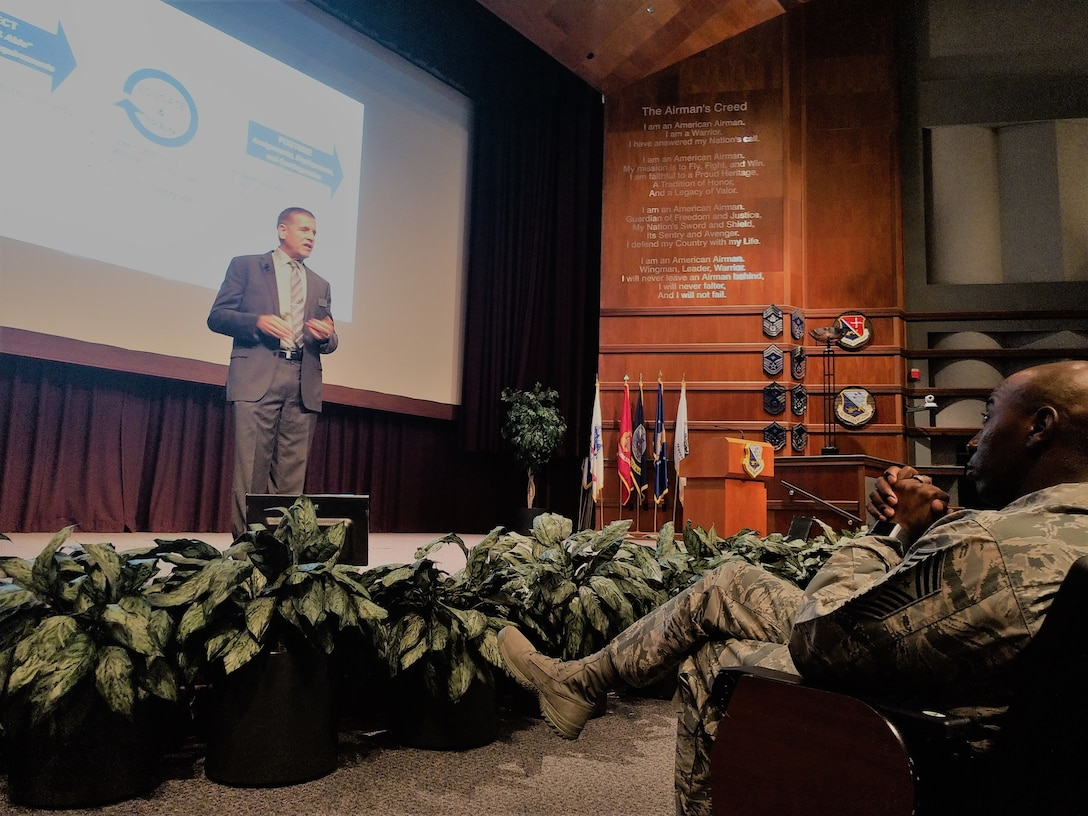 Mr. Howard Ward, Director of the Air Force Culture and Language Center, speaks to Chief Master Sergeant Kaleth O. Wright about the Culture and Language Center at the Senior Non Commissioned Officer Academy at Maxwell AFB Gunter-Annex, AL on 14 August, 2018. The presentation was part of a series held as top enlisted leaders from international partner nations attended a summit.