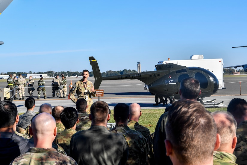 Lt. Col. Tim Foster, 437th Operations Group special operations director, gives a speech during the dedication of an OH-6 Cayuse, Nov. 16, 2018, at Joint Base Charleston, S.C. The helicopter, donated by the Defense Logistics Agency, was refurbished by the 437th Maintenance Group for the special operations unit to use for training. It will be used by their loadmasters to train winching and helicopter loading procedures, as well as rapid loading and offloading procedures in blacked out conditions.