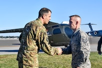 Tech. Sgt. James Moreland, 437th Maintenance Squadron metals technologist, receives a coin for helping refurbish a donated training helicopter for the 437th Operations Group special operations unit, Nov. 16, 2018, at Joint Base Charleston, S.C.