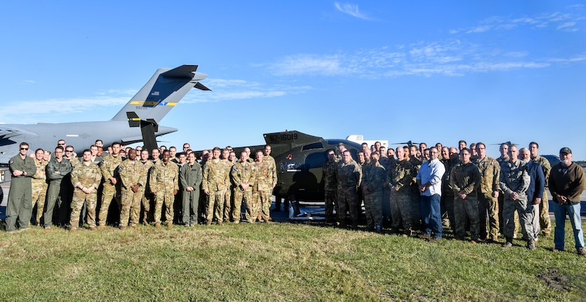 Airmen from the 437th Operations Group special operations unit pose in front of their new training helicopter Nov. 16, 2018, at Joint Base Charleston, S.C.