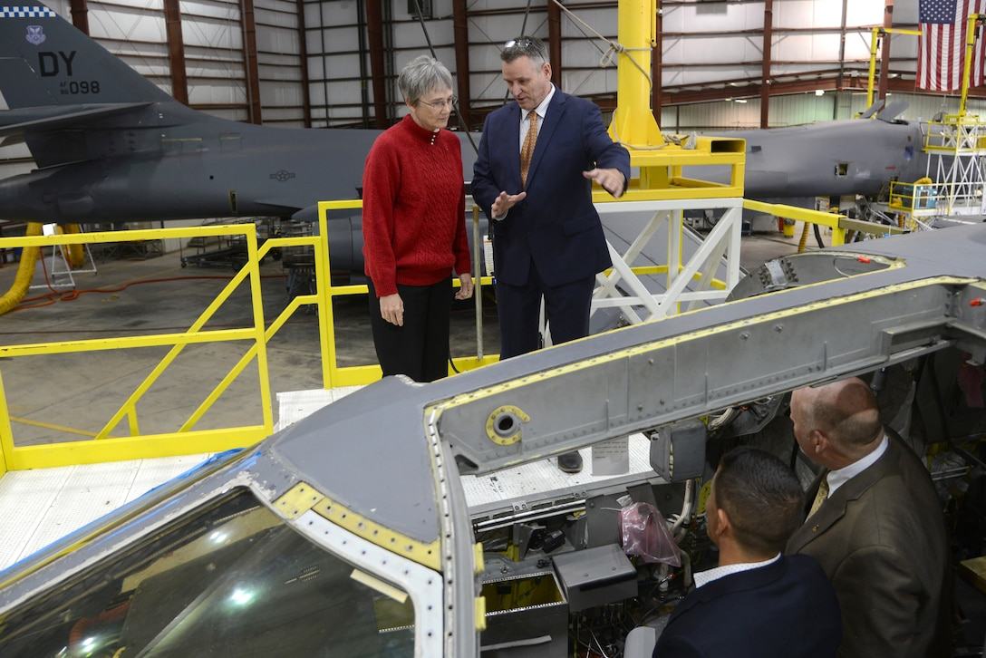 Rodney Shepard, 567th Aircraft Maintenance Squadron deputy director, provides an overview on the B-1 Integrated Battle Station modification operations to Secretary of the Air Force Heather Wilson during her tour of Tinker Air Force Base Nov. 16. Jason Mann, an engineer with the Reverse Engineering and Critical Tooling Lab, bottom left, and Jerry Osborne, 567th AMXS, also provided information on the modifications during her time at the Maintenance Repair and Overhaul Technical Center.