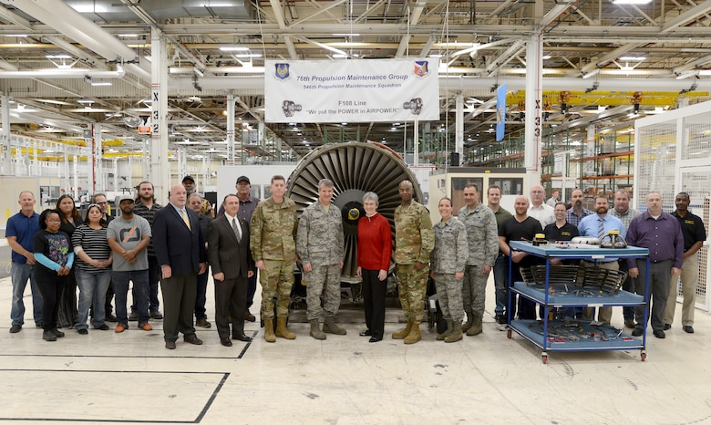 Secretary of the Air Force Heather Wilson, center, was able to thank members of the 76th Propulsion Maintenance Group F108 engine line after learning about their Art of the Possible production success. Wilson is surrounded by senior leadership here as well as workers critical to meeting on-time delivery goals to the customer.