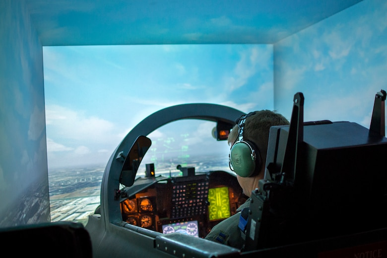 A U.S. Air Force student pilot checks instruments while flying in a T-38C Talon flight simulator on Nov. 8th at Joint Base San Antonio - Randolph. Simulators play a key role in Introduction to Fighter Fundamentals and pilot training.
