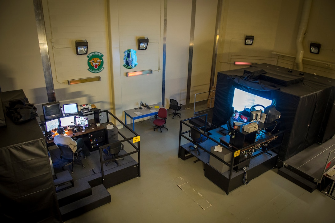 Two 12th Training Squadron instructor pilots teach student pilots in T-38C Talon simulators during Introduction to Fighter Fundamentals on Nov. 8, 2018 at Joint Base San Antonio - Randolph. These simulators allow students to fly in a wide range of conditions and create a variety of challenges for the students to overcome.