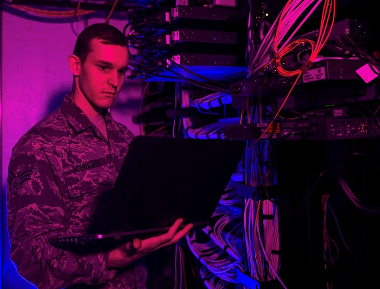 Senior Airman Alexander Schrichte, 460th Space Communications Squadron client systems technician, performs routine technical checks on network servers, Nov. 9, 2018 at Buckley Air Force Base, Colo. Buckley AFB was handpicked alongside of six other bases to pilot a new program called Network As A Service, or NAAS, which benchmarks the way cyber deterrence in the U.S. Air force is accomplished across the globe. Airmen belonging to the 460th Space Communication Squadron will no longer be limited to fixing technical issues, they will be defending our nation from cyber attacks. (U.S. Air Force photo by Airman 1st Class Michael D. Mathews)