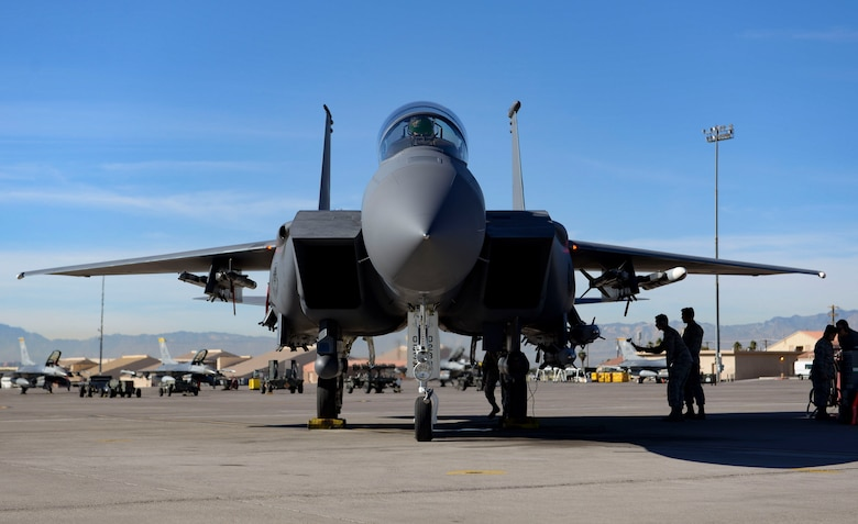 An F-15E Strike Eagle fighter jet prepares to launch during a Gunsmoke Competition Nov. 15, 2018 at Nellis Air Force Base, Nevada. From weapons personnel loading the live weapons and crew chiefs perfectly launching the aircraft, to pilots using those weapons to hit their targets, each team was judged on their safety and execution. (U.S. Air Force photo by Airman Bailee A. Darbasie)