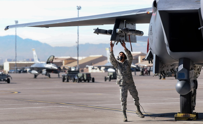 Airman 1st Class Bonifacio Garcia, 757th Aircraft Maintenance Squadron Strike Aircraft Maintenance Unit F-15E Strike Eagle fighter jet maintainer, inspects an F-15E before flight Nov. 15, 2018 at Nellis Air Force Base, Nevada. Crew chiefs are required to perform inspections prior to every launch. (U.S. Air Force photo by Airman Bailee A. Darbasie)