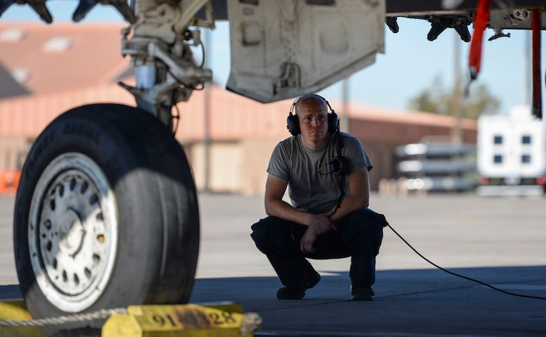 Senior Airman Joshua Cowart, 757th Aircraft Maintenance Squadron Strike Aircraft Maintenance Unit F-15E Strike Eagle fighter jet maintainer, prepares an F-15E for launch Nov. 15, 2018 at Nellis Air Force Base, Nevada. Cowart was one of many participants representing Strike AMU during a Gunsmoke Competition at Nellis. (U.S. Air Force photo by Airman Bailee A. Darbasie)