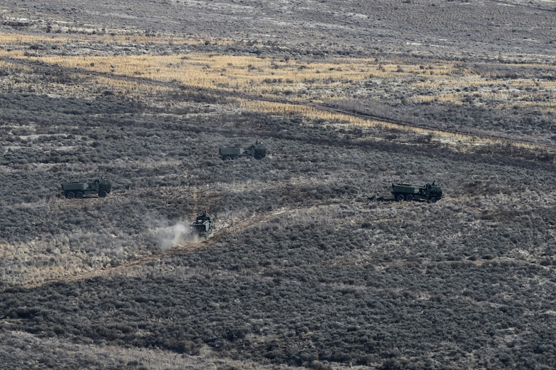 Four U.S. Army High Mobility Artillery Rocket System (HIMARS) vehicles get into position to fire rocket artillery as part of a training exercise and to celebrate the re-opening of the Selah Airstrip on Yakima Training Center, Washington, November 15, 2018.
