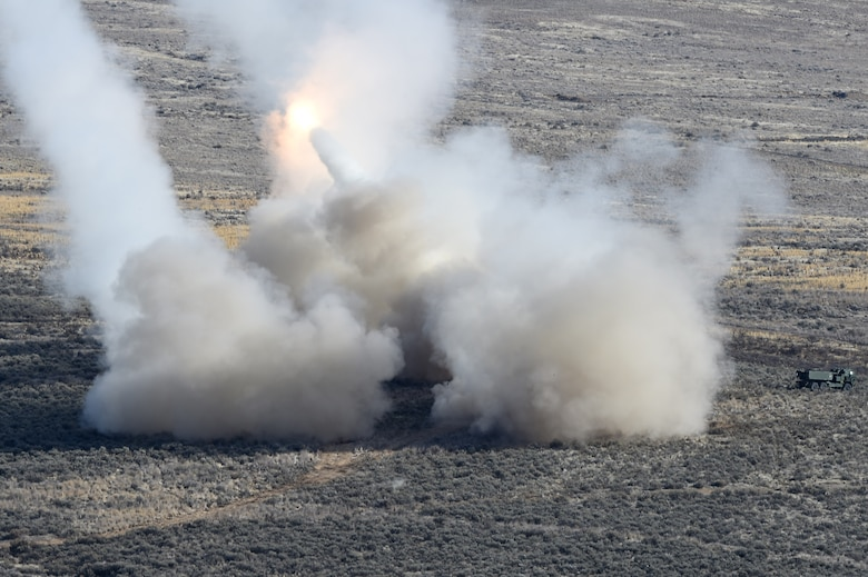U.S. Army High Mobility Artillery Rocket System (HIMARS) vehicles fire rocket artillery as part of a training exercise and to celebrate the re-opening of the Selah Airstrip on Yakima Training Center, Washington, Novemeber 15, 2018.
