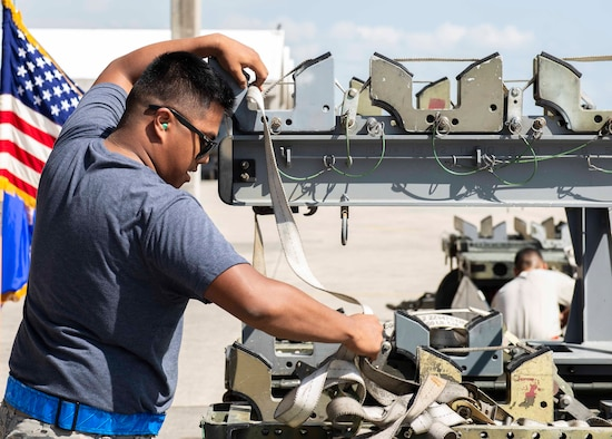 U.S Air Force Airman 1st Class Simon John Delaney, 44th Aircraft Maintenance Unit weapons load crew member, races against the clock to complete final tasks during a load competition Oct. 26, 2018, at Kadena Air Base, Japan. The units completed their tasks within mere seconds of each other.