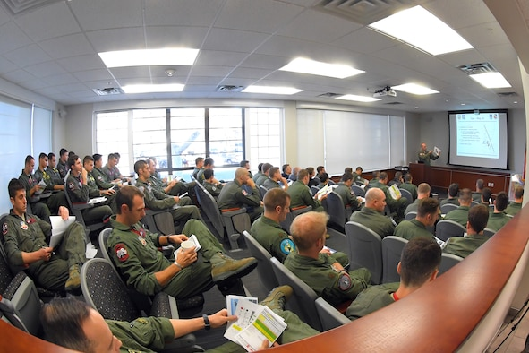 F-35A pilots from the 388th and 419th Fighter Wing go through their mission brief as they prepare for a combat power exercise at Hill Air Force Base, Utah. The exercise aims to confirm their ability to quickly employ a large force of jets against air and ground targets, and demonstrate the readiness and lethality of the F-35 Lightning II. As the first combat-ready F-35 units in the Air Force, the 388th and 419th FWs are ready to deploy anywhere in the world at a moment's notice. (United States Air Force photo/Todd Cromar)