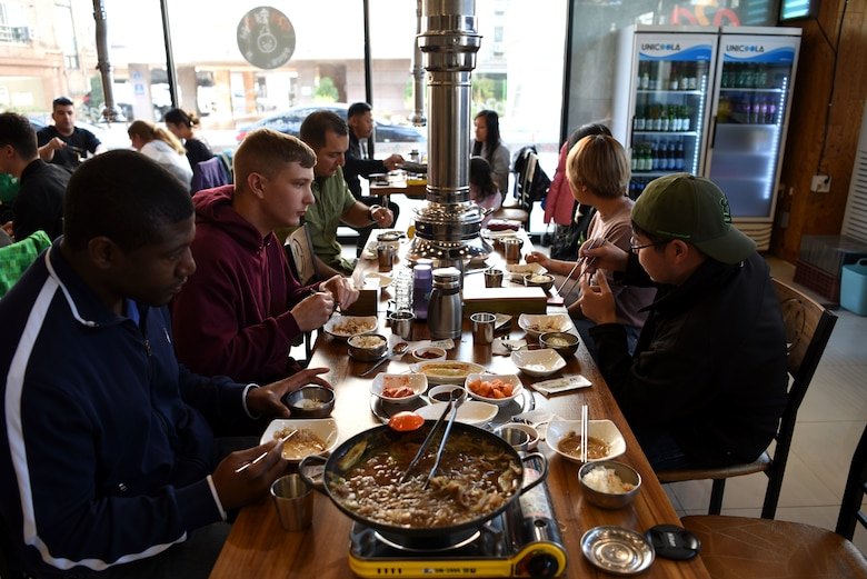 Members of Team Osan, along with local guides, enjoy a Korean lunch during the Head Start Program in Pyeongtaek, Republic of Korea, Nov. 11, 2018. The two-day program is designed to give ROK newcomers a first-hand look at Korean customs and culture, as well as imparting helpful information such as local laws. (U.S. Air Force photo by Senior Airman Kelsey Tucker)