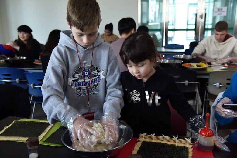 Children from Osan Air Base, Republic of Korea learn how to make kimbap during the Head Start Program at Pyeongtaek University, Pyeongtaek, ROK, Nov. 13, 2018. The program aims to improve the quality of life for service members, their dependents and civilians stationed in the ROK by teaching them about Korean society, culture and the history of the U.S.-ROK alliance. (U.S. Air Force photo by Senior Airman Kelsey Tucker)