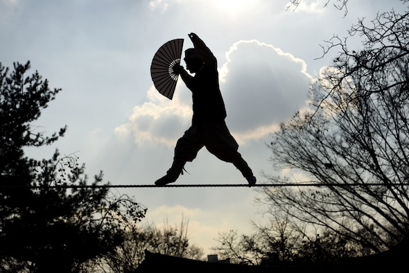 A performer showcases acrobatics on a tightrope at the Korean Folk Village, Yongin, Republic of Korea, Nov. 13, 2018. The Korean Folk Village was the last stop of the Head Start Program, which included two days of informational classes and hands-on experiences around the Gyeonggi Province of South Korea. (U.S. Air Force photo by Senior Airman Kelsey Tucker)