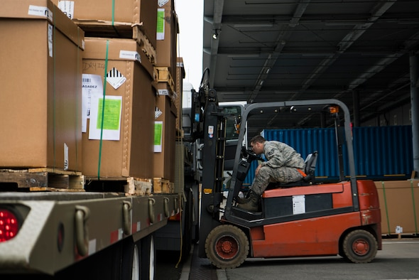U.S. Air Force Staff Sgt. Richard Leseberg, 721st Aerial Port Squadron, noncommissioned officer in charge of in-transit munitions facility, loads a pallet of rations onto a truck on Ramstein Air Base, Germany Oct. 31, 2018. The 521st Air Mobility Operations Wing hosted a flight commander course instructing company grade officers who are slated to lead operations like logistics in flight commander roles. (U.S. Air Force photo by Senior Airman Devin M. Rumbaugh)