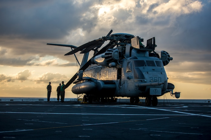 U.S. Marines stand next to a CH-53E Super Stallion with Heavy Marine Corps Helicopter Squadron 462, Special Purpose Marine Air-Ground Task Force - Peru, aboard the San Antonio-class amphibious transport dock ship USS Somerset in the Pacific Ocean, Nov. 16, 2018. SPMAGTF-Peru is part of U.S. Southern Command's Enduring Promise initiative and reflects the United States' enduring promise of friendship, partnership and solidarity with the Americas.